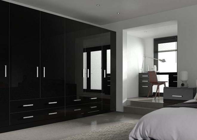 New wardrobe doors are a great way of revitalising your bedroom. Shown: Visions Ultragloss Black
