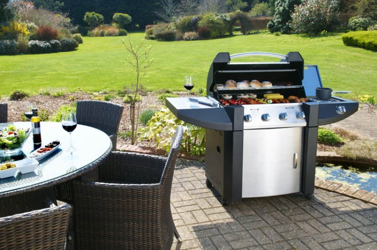 A barbeque and some elegant patio furniture give your garden so much character.