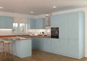 kitchen with pale blue cabinet doors and wooden worktops