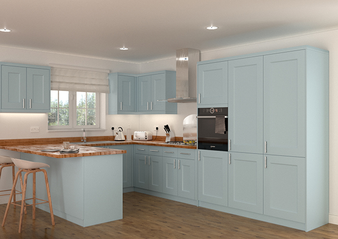 Pale blue kitchen units with wooden worktops