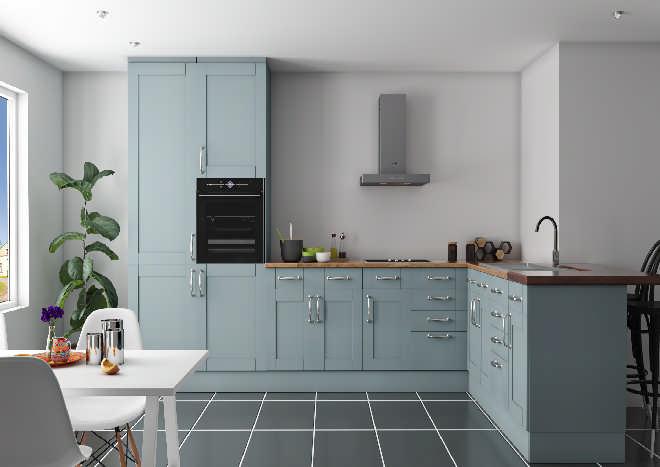 blue shaker kitchen doors, white walls, grey floor tiles